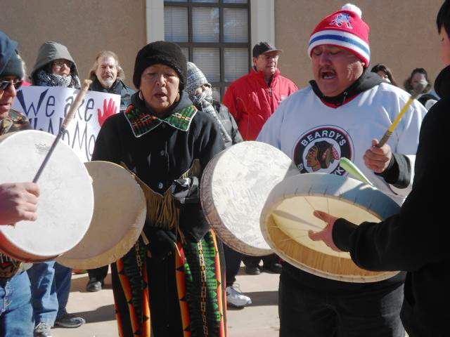 Drums and song set the tone for the Idle No More flashmob at the New Mexico State Capitol in Santa Fe.