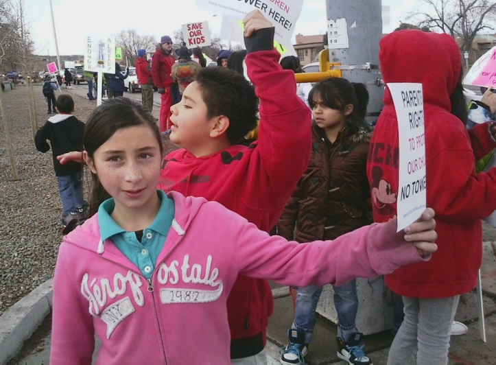 Gonzales School 5th grader Anjoli Griego protesting the plan for a cell tower next to her school.