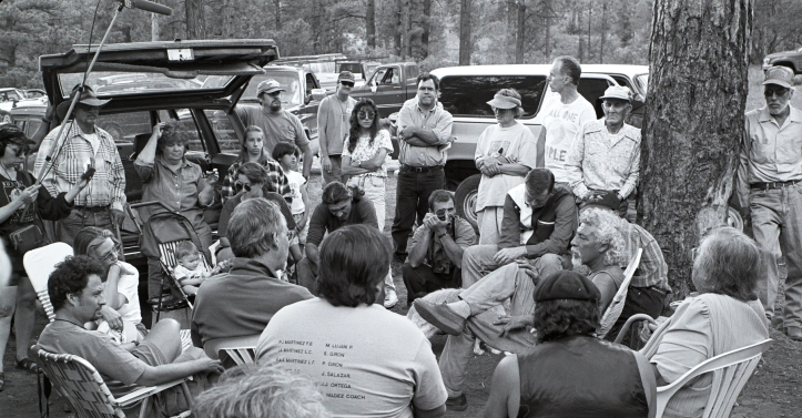 Ike de Vargas and Sam Hitt meeting in the woods. In back on the left, KUNM radio journalist Catalina Reyes holds a tape deck, boom pole and microphone: do those tapes still exist? Click on image to enlarge.