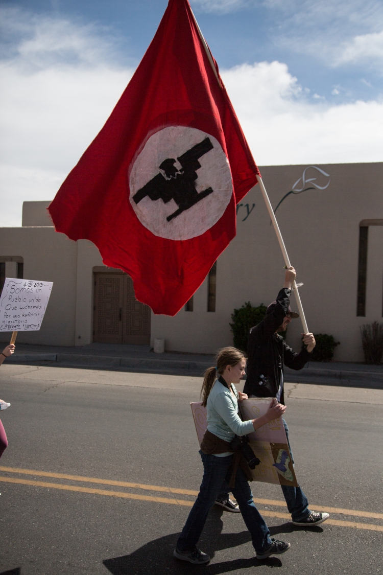 Marchers carrying the familiar United Farm Workers flag led the march north from the National Hispanic Cultural Center