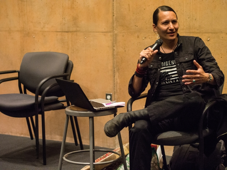 Former lead singer of the punk rock band Blackfire, Klee Benally discusses the importance of ongoing struggles against settler colonialism and the continued desecration of Indigenous lands through extractive mining, tourist and resort economies, and tribal and resource industry's collaboration in asymmetrical dispossession of Black Mesa's Dine' community from access to basic needs.
