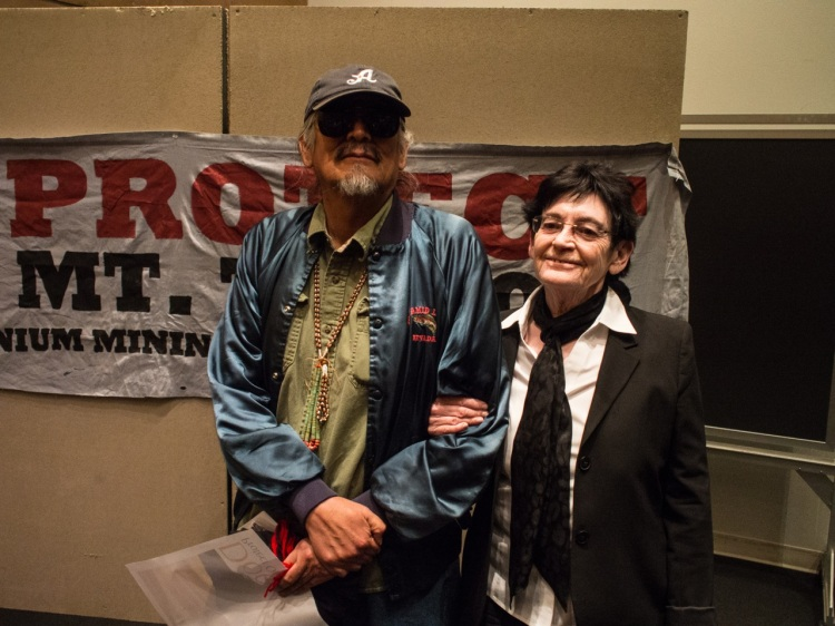 Scores of scholars and activists travelled from all over to attend the event and honor John Redhouse. Here scholar, author and activist Roxanne Dunbar-Ortiz poses with John following his keynote.
