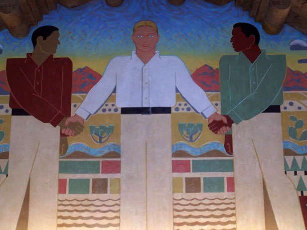 Kenneth Adams mural in UNM Zimmerman Library, circa 1937. This image captures the ways that white elites positioned themselves as the enlightened leaders of Mexicano and Pueblo communities, and the MRGCD was no exception to this dynamic. Photo by Sam Markwell