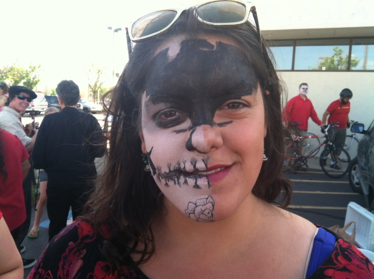 """Zombie"" marcher Santana, with La Raza Unida, included the Aztec Eagle of the UFW on her forehead as part of her zombie make-up."