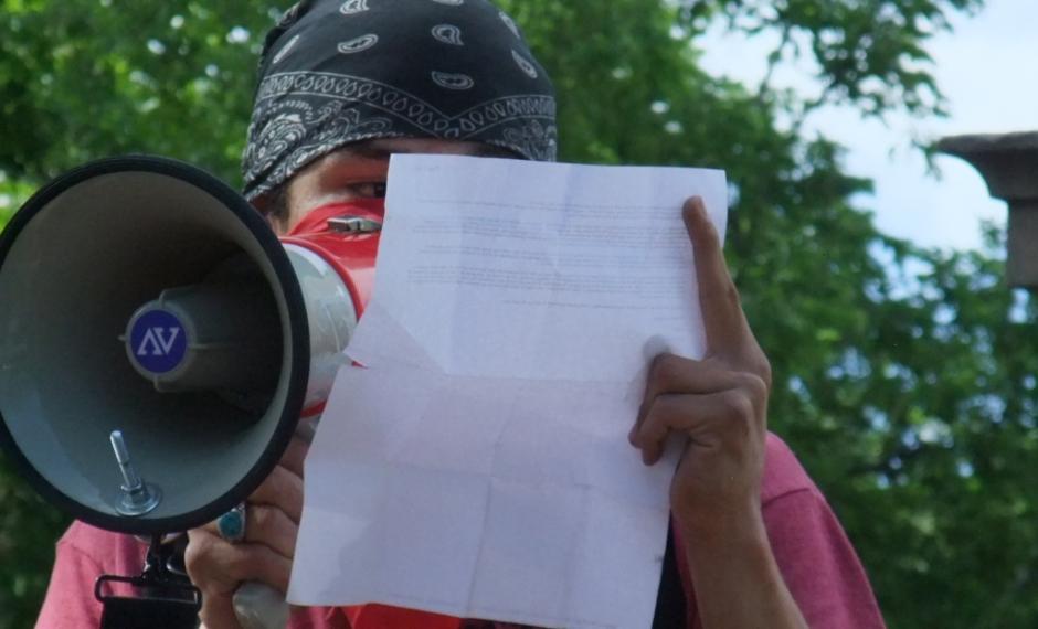 Dine activist Kooper reads a letter from prison from Leonard Peltier.