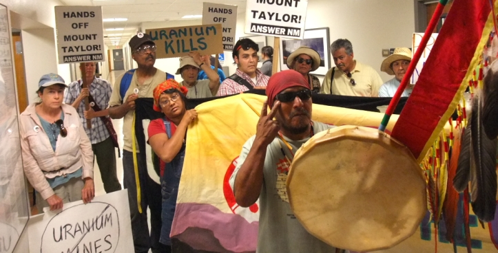 Filling the hallway of the Mining and Minerals Division offices, protestors insist the agency deny the permit for the Roca Honda uranium mine on Mount Taylor, at least until cleanup is complete at all other New Mexico uranium mines.