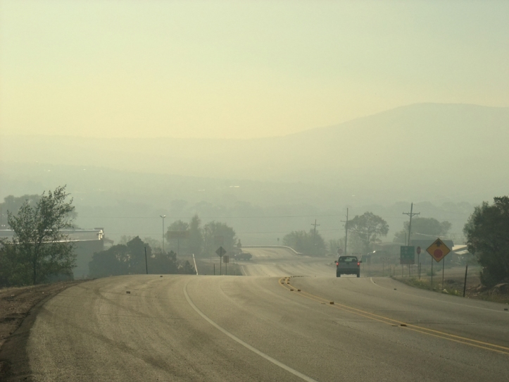 The village of Pecos covered in smoke from the Tres Lagunas Fire. Eric Shultz photo