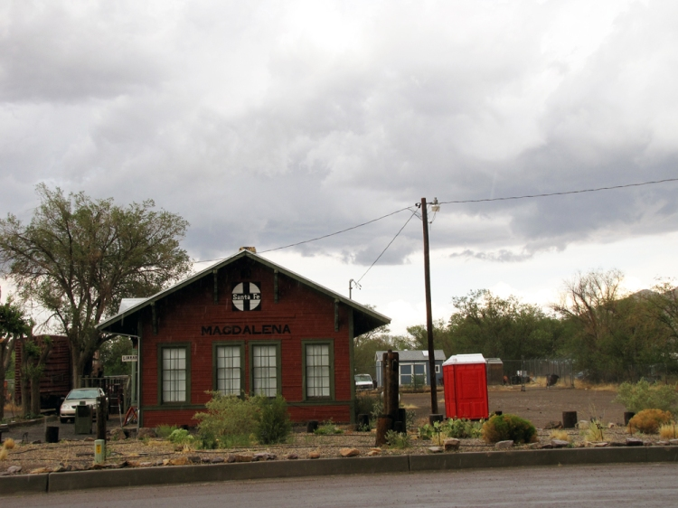 the Magdalena rail depot, now just a tourist site and location of the village library. The red portable toilets next to it are more common than people on the streets of town.