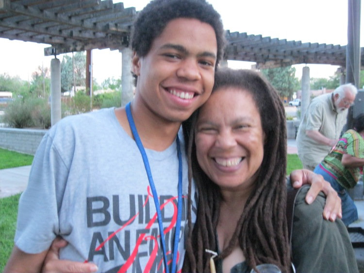 "Malcolm, a nineteen-year old UNM student, attended the rally with his mother, Ramona. Both spoke at the vigil. Ramona reminded all that unity was essential if we were going to interrupt racism. Malcolm wondered what kind of person Trayvon Martin would have been. ""There's no telling what Trayvon could have done."""