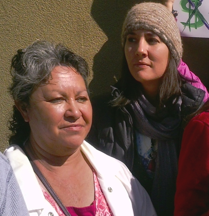 Chimayo farmer and New Mexico Acequia Association staffer Pilar Trujillo stands with Ginia Gallegos at the rally.