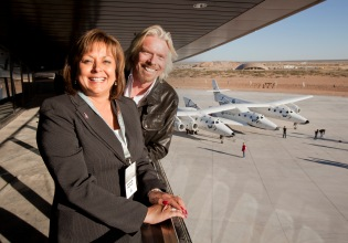 Governor Susana Martinez and Richard Branson posing at the New Mexico Spaceport