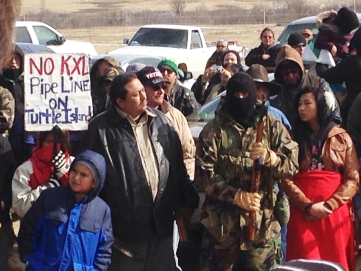 Lakota activists at the 41st Annual Wounded Knee Liberation Day, Wounded Knee, SD, February 28, 2014, prepare to stop the proposed KXL Pipeline, which would cross treaty-protected territory. Photo by Chas Jewett.