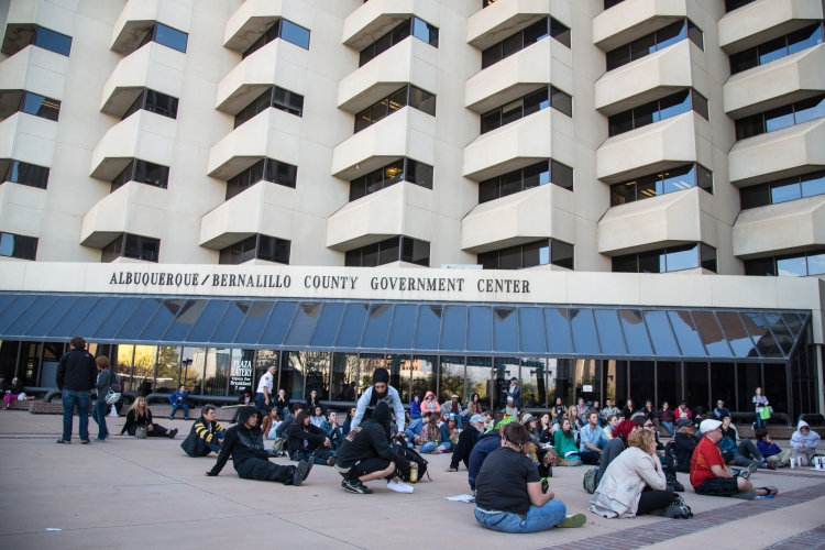 Outside the Albuquerque/Bernalillo County Government Center, hundreds of attendees watched the council meeting via livestream. Because of fire regulations, seats were limited in the council chambers.