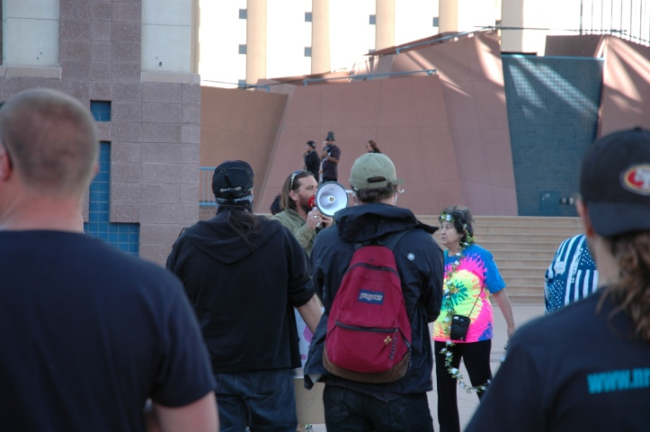 The protest begins on Civic Plaza with speakers on bullhorns. Photo by Charles Arasim