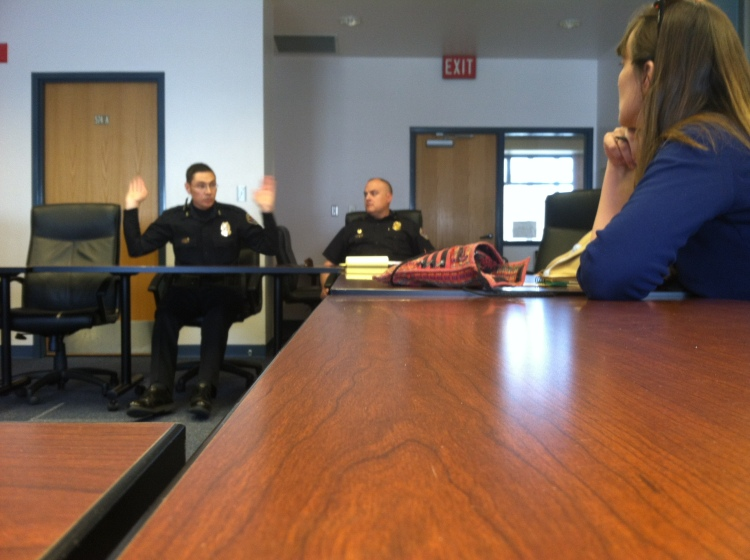 Our meeting with APD: On the right, APD Commander Tim Gonterman. On the left, APD Deputy Chief Macario Page. No. He's not surrendering. He's in the middle of his speech on patriotism.