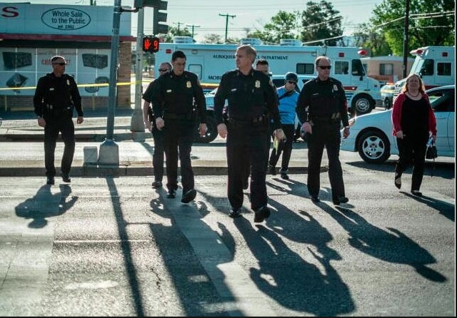 Chief Eden (center), was joined at the scene with Assistant Chief Huntsman, hired recently to implement DOJ reforms (right), Deputy Chief Page (left) and other APD and city officials. Photo by Roberto Rosales (shared via soical media).