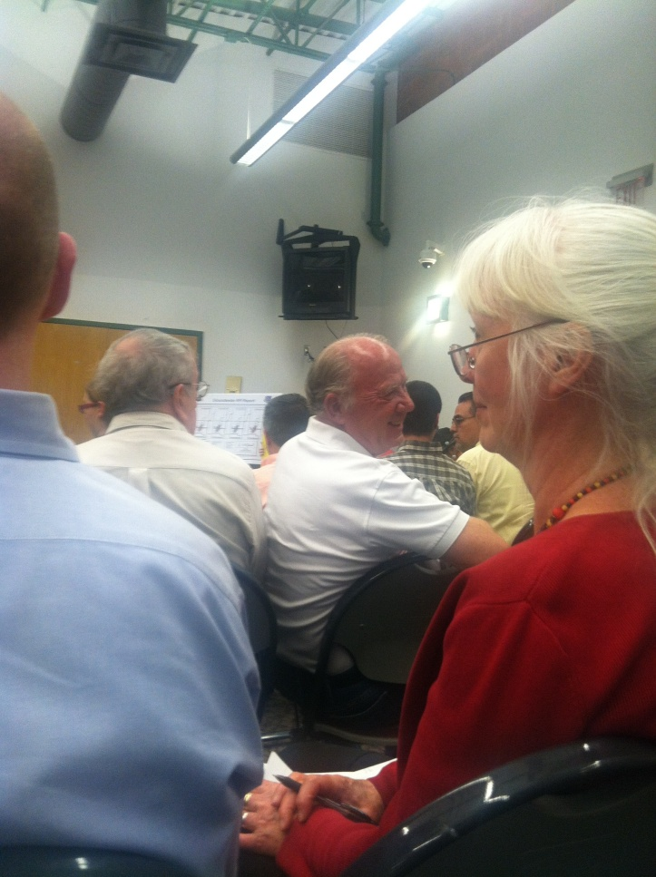 Throughout the meeting, McCorkle glared at critics of KAFB. He would turn bright red and glare. Here he glares at a man who called for KAFB to close up and leave town. Photo by Willa Correia-Kuehn (she was glared at too. And then she started taking his photo)
