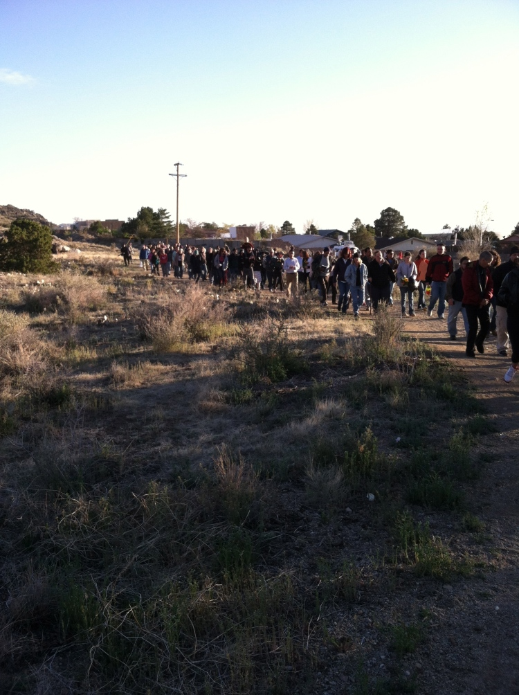 """More than 200 people gathered at the Copper Trailhead in Albuquerque at 6:30 PM on April 2, 2014 and together hiked up to the U-Mound for a candlelight vigil in memory of James """"Abba"""" Boyd"""