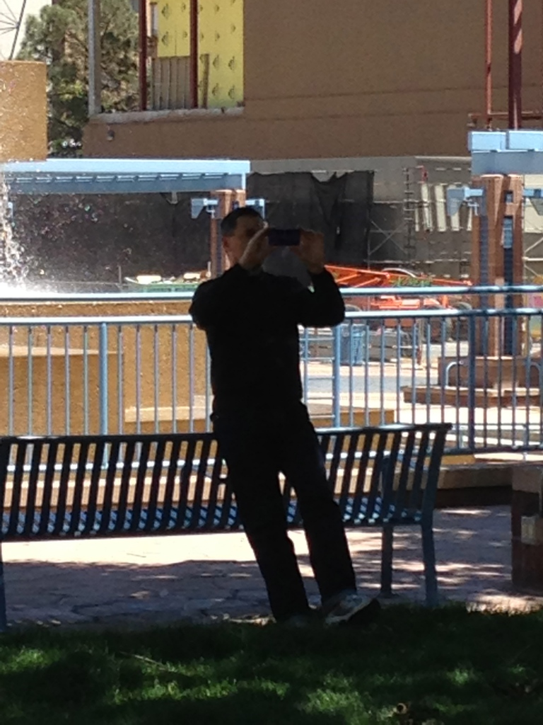 Do you know this man? He circled the group of protesters engaged in discussion pretending to take pictures of trees and rocks in Civic Plaza. Photo by David Correia