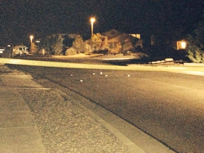APD marks bullet casings on the street in front of Armand Martin's home. Photo by Ben George