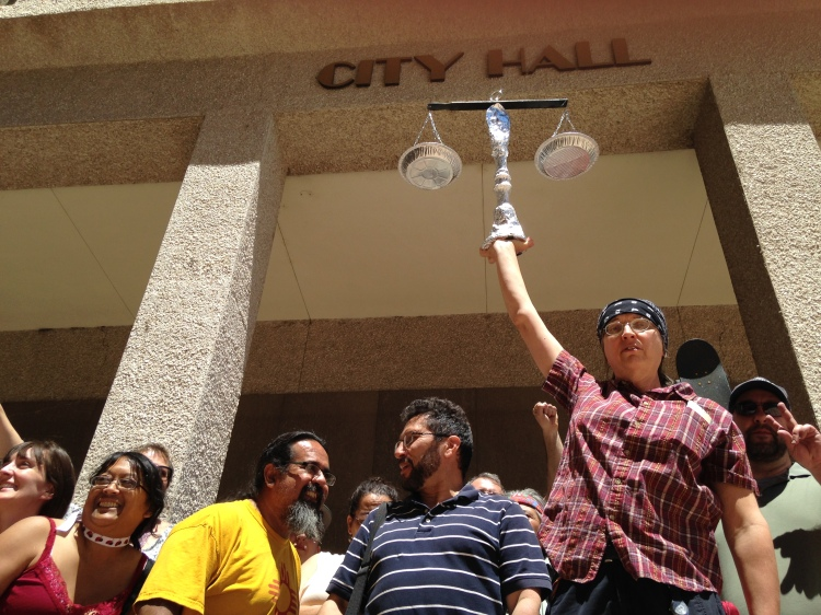 Protesters after carrying the scales of justice from the DOJ hotel to the City Hall. Photo by David Correia