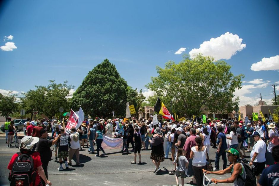 The marchers returned to Roosevelt Park after about one and half hours in scorching heat.
