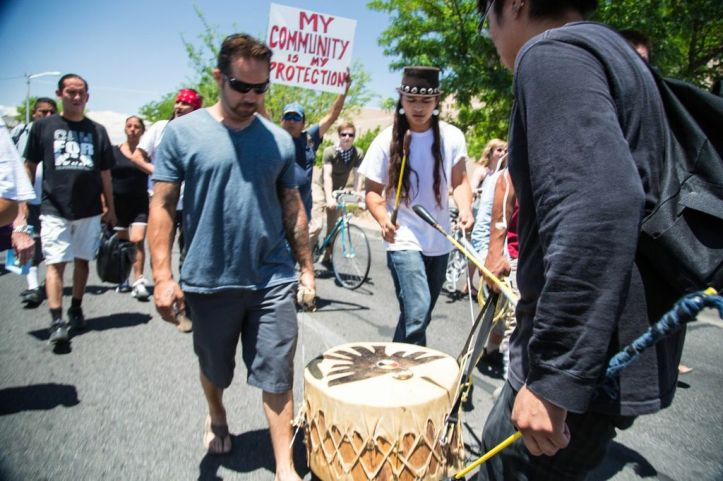 While most marchers chanted slogans in English and Spanish, Albuquerque's Native community kept cadence at the rear of the march with songs in Kewa, Diné, and Lakota, as well as honor songs for the marchers and victims of police violence.