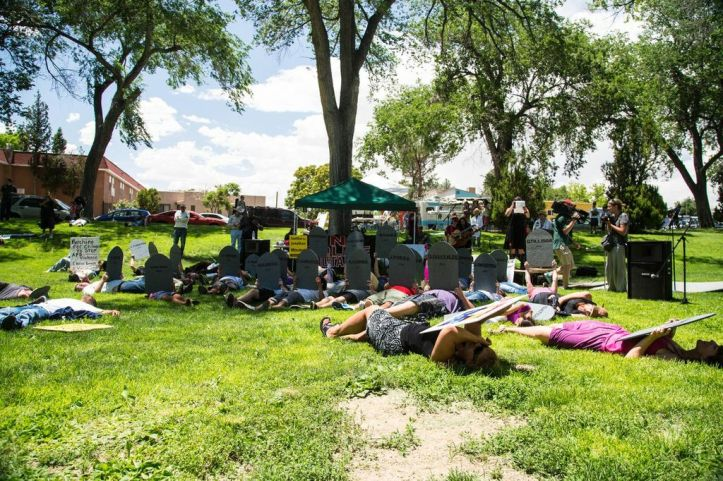 """Participants staged a """"Die-In"""" in honor and remembrance of those killed by APD and people affected by police violence. A moment of silence was held in honor of those victims."""