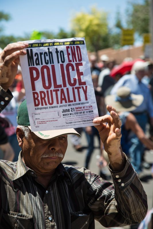 "A marcher holds the flyer on Saturday, June 21, ""March to End Police Brutality."""