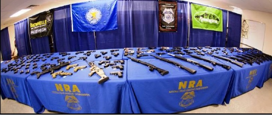 The competition provides plenty of opportunity in the exhibit hall for competitors to browse the military weaponry peddled to local police by official sponsors