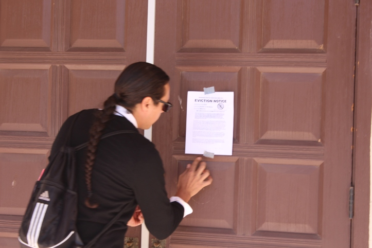 A delegation tapped the eviction notice to the door of Scholes Hall