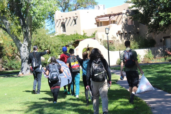 Frank took the eviction notice, turned, and walked to the official Presidential residence at the center of UNM's campus. The tour followed him.