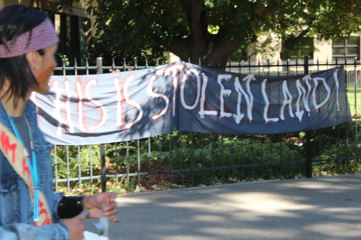 Another group tied a banner to the gate that surrounds the President's house.