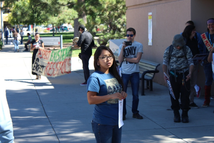 """Where are we in the UNM seal?"" asked Cheyenne Antonio, a UNM student and the President of the Kiva Club.  ""I'm glad we're here,"" she told the marchers, ""and standing up for ourselves."""