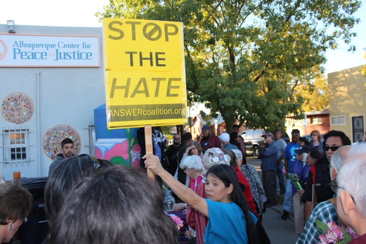 Attacks and vandalism at the Islamic Center of New Mexico on Yale in Albuquerque is not new. It happened again last Friday, when security cameras at the mosque captured video of a group of people throwing a homemade firebomb at the Mosque. In response a number of local organizations held a peace march yesterday, October 30, 2014. Marchers began assembling at 5 PM outside the Albuquerque Center for Peace and Justice