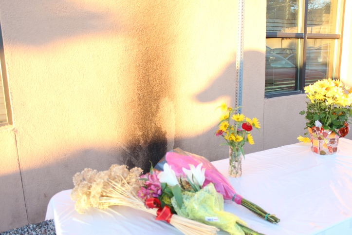 Meanwhile, on the south side of the Mosque, marchers laid flowers on a table in front of the site of the firebombing.