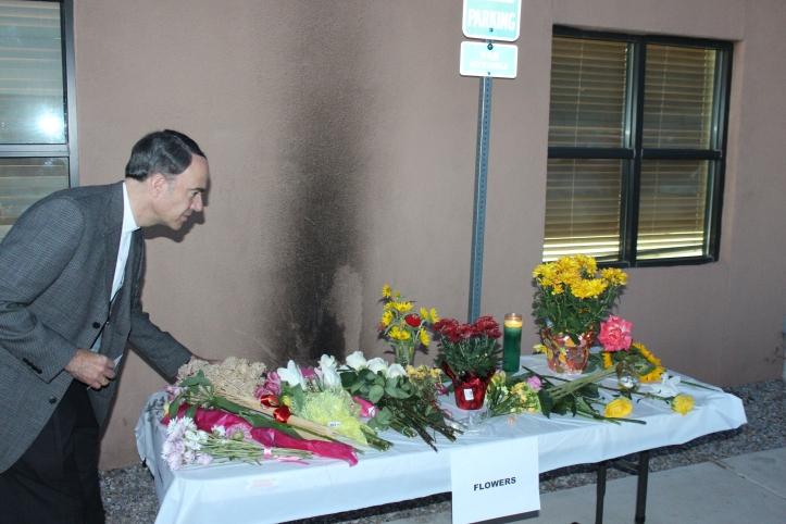 Before leaving, marchers left flowers at the site of the attack in order to turn a site of hate in a place of beauty.