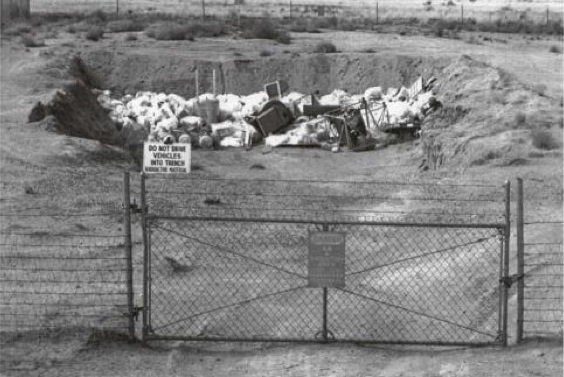 A view of trench D in 1967. Much of the toxic or radiocative wastes were dumped in plastic bags or cardboard boxes.
