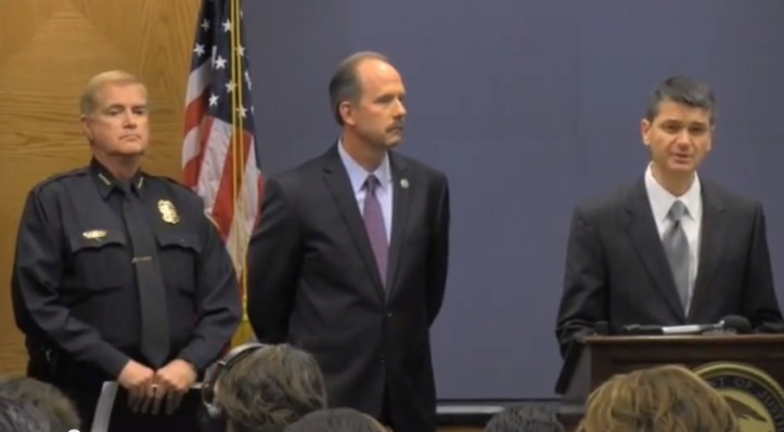 Mayor Richard Berry (center) and Gorden Eden (left) pretending to take seriously the allegations of police wrongdoing by United States Attorney Damon Martinez (at podium) on October 31 press conference announcing the release of the consent decree.