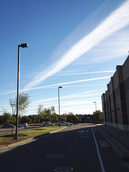Monday, October 20, 2014, 8:40 a.m. taken beside Fresh Market on International Drive looking east across Military Cutoff Road in Wilmington, North Carolina. Note how the lines of contrails have spread out and blended together. Photo by author
