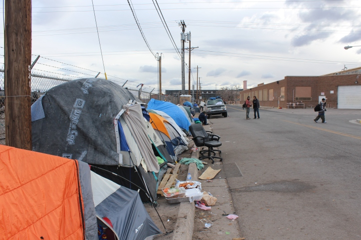 This was the scene at Tent City mid-day on Wednesday, February11, 2015. Tent City is a homeless camp in Albuquerque's downtown that sprang up last fall along First Street and Iron Avenue, just west of the railyards. For months the City, which says it wants to turn First Street into a boulevard for shoppers  between downtown and the newly redeveloped railyards, had been trying to remove residents.