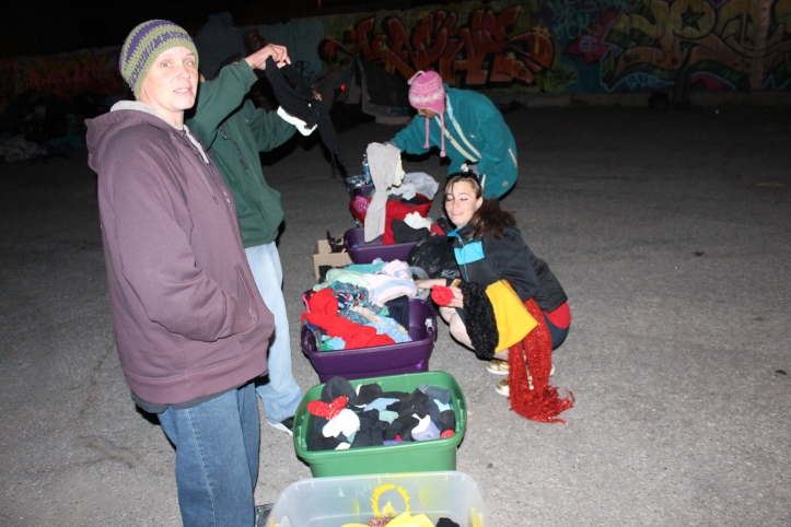 "While people set up their camps and ate dinner, Two-tone Grant (left) pulled up in a van and unloaded donated clothing and supplies for residents. She told me she runs her community outreach effort, ""A Light in the Night"" out of her own house. Visit her facebook site ""A Light in the Night Community Outreach"" to donate supplies."
